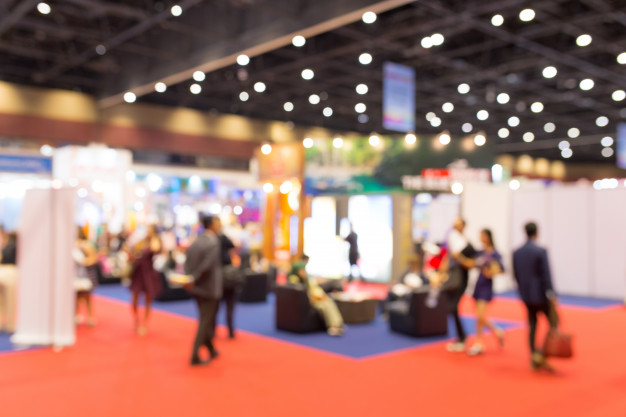 abstract-blurred-event-exhibition-with-people-background-business-convention-show-concept_34168-452